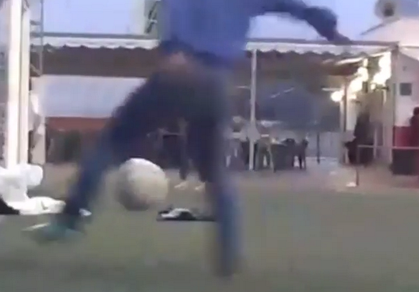 NUTS! Kid pulls off awesome 180° panna trick on his mate! [Video]