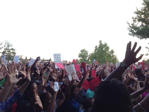 """The """"hands up, don't shoot"""" chant earlier. Sign-up sheets going around too http://t.co/LFjfv6ows9"""