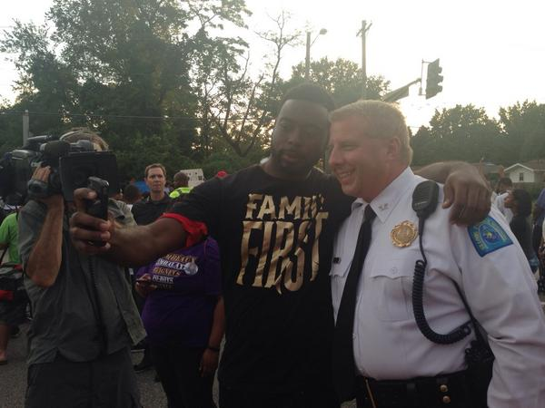 St. Louis Police Chief Sam Dotson taking a selfie with a protestor. This is a CHANGED atmosphere. #Ferguson http://t.co/Jm51iZXdvz