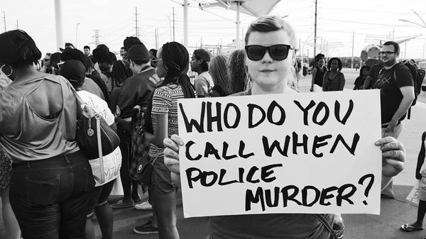 "Pic from Dallas #NMOS14 - ""Who do you call when the police murder?"" http://t.co/yCnR3S78kf"