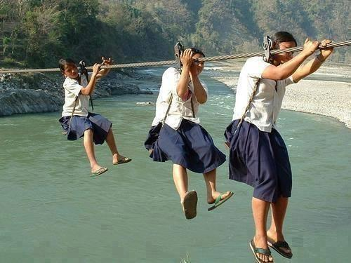 Girls on their way to school in Nepal. No bridge, no other way to get there. http://t.co/lxpobzFvht via @BinaShah
