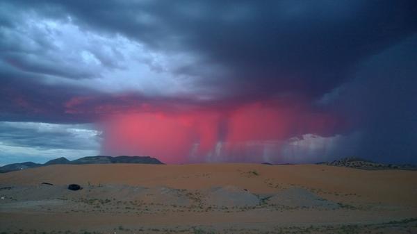 Beautiful! The sun lights up a rain shaft just before sunset this evening.  Photo courtesy James Reidland http://t.co/XcZ2qdAv7c