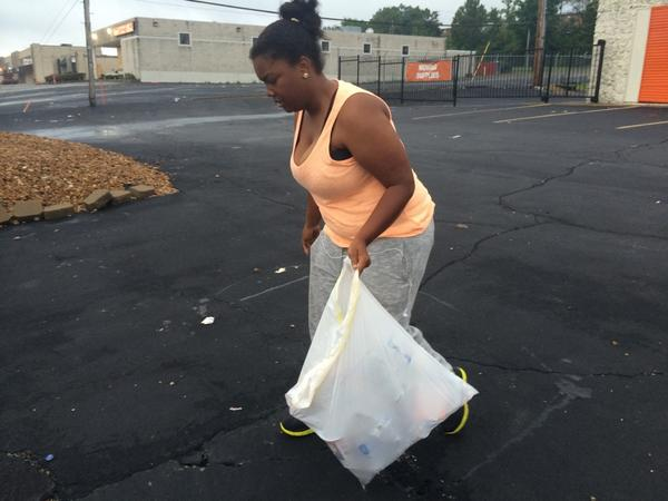 Here are the faces of the people of #Ferguson, cleaning up their community this morning: http://t.co/XoknIbG8rC