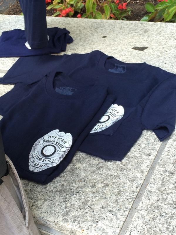 Shirts on sale with police style badge saying quot officer darren wilson