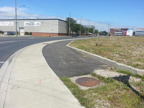 Asphalt strip on Longwood starts at Aberdeen