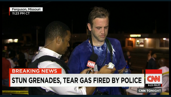 Freelance photographer from Albuquerque took a Tear gas canister direct hit in #Ferguson now live on @CNN http://t.co/d624OQzmaK