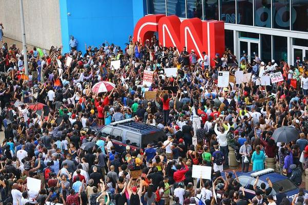 Damnnn they did it! Twitter WORKS! RT @passantino: protest  outside of CNN's headquarters in Atlanta #MichaelBrown http://t.co/YiO9USGyDg