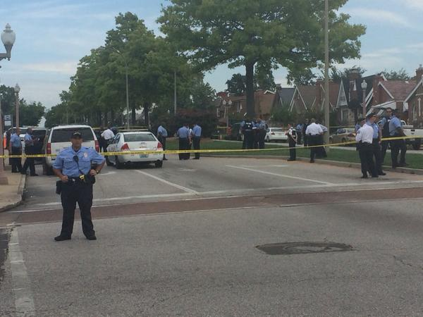 Police confirm officer-involving shooting in St. Louis. Many spectators gathering. Heavy police presence. http://t.co/rAdjLqpRLY