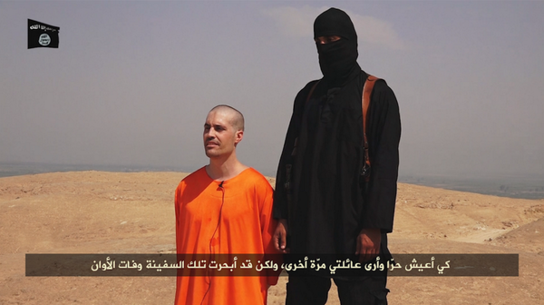 "BREAKING: Islamic State, in video titled ""A Message to America,"" beheads American journalist James Wright Foley http://t.co/Y8yZcKTa6m"
