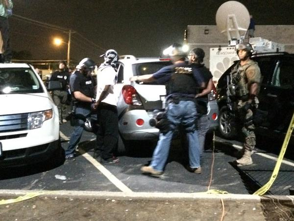 Two men just arrested on top of my rental car in #Ferguson. http://t.co/7E4kgPCxuH