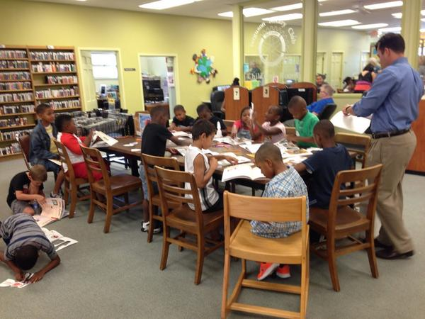 High five to @fergusonlibrary! RT @ryanjreilly Children and volunteers in the #Ferguson Public Library http://t.co/XU0en5Atwi