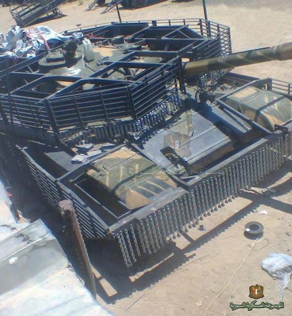 シリア政府軍 T-72 ここまでスラットアーマー化するとは.... http://t.co/3HmMrp1cLM