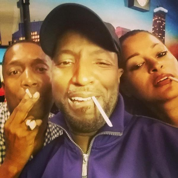 Rickey Smiley smoking a cigarette (or weed)