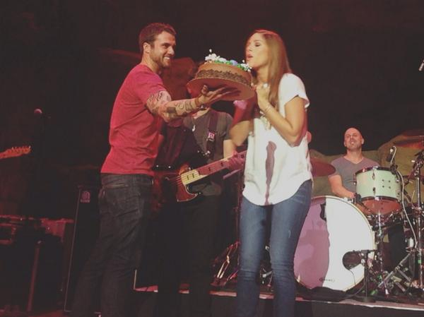 Another great @CassadeePope show! Here's a good picture of @riandawson bringing a cake on stage!