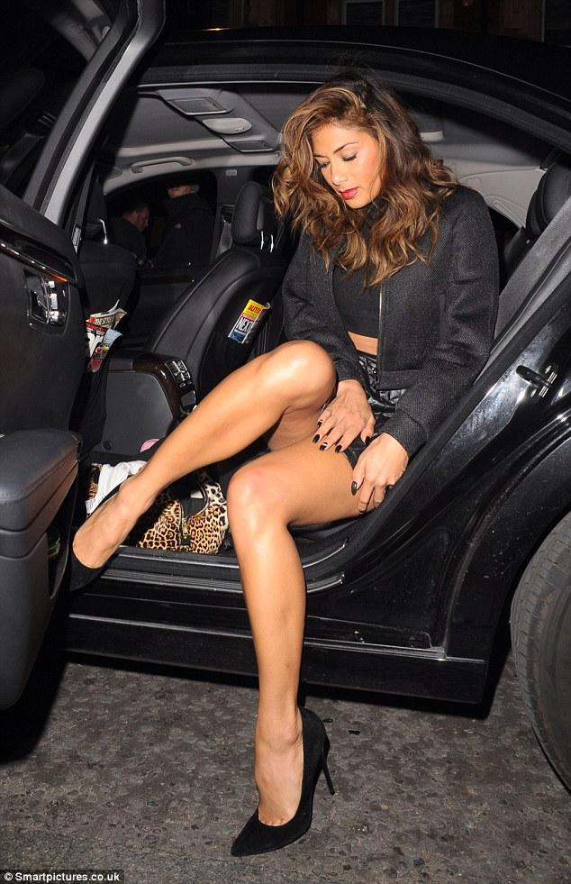 Celebrity getting out of cars