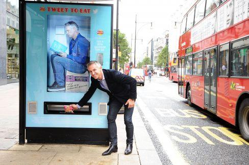 Walkers transforms London bus stops into tweet-activated @WALKERS_BUSSTOP vending machines http://t.co/aUsfBKzGLd http://t.co/yctDeQMzSh