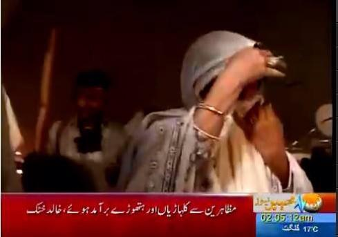 IK's sister ali a khan facing tear gas right along with Pakistani people #awamipressure #islamabadmassacre http://t.co/oSYNtyxjZ7""
