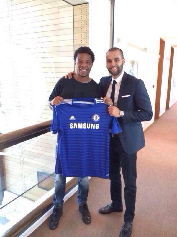 DONE DEAL! Chelsea sign Loic Remy from QPR. Striker poses with Blues shirt