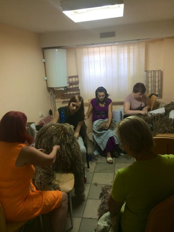 Women hand-stitching camouflage suits for soldiers in #Mariupol. #Ukraine http://t.co/BN6pCVzgbP