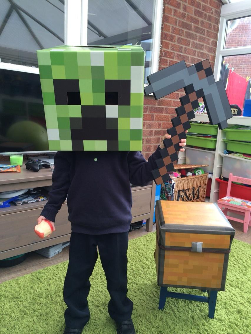 Tom loves his creeper head and axe!! #minecraft http://t.co/5mIPDIQGYp