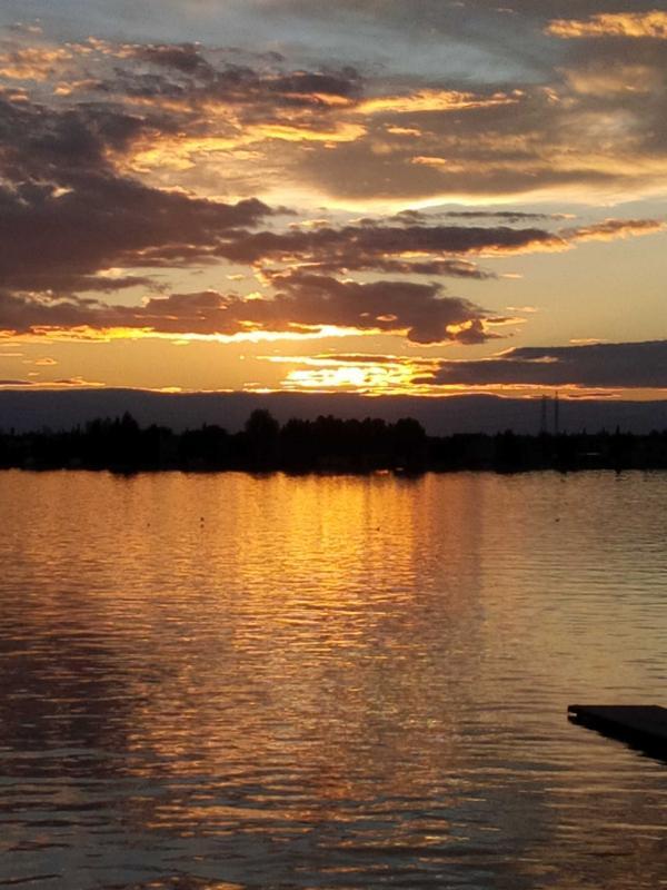 A golden glow over Chestermere lake tonight. http://t.co/kzbmpwBYak