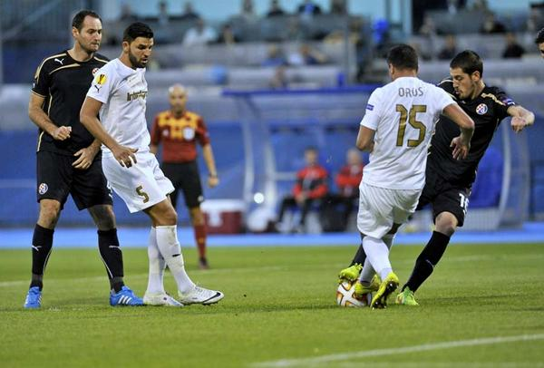 Ademi competes for the ball with an Astra player
