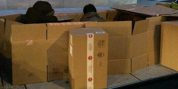 The iPhone 6 line is 12 blocks long — and people are sleeping in boxes http://t.co/D2HOyjyqEK http://t.co/ZCKDkVFgMk