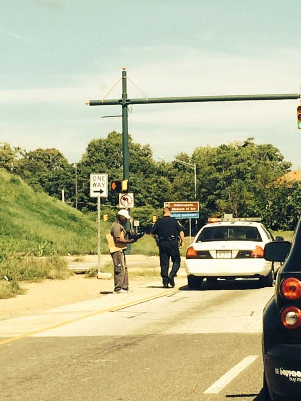 Just seen an Indy police officer pull over. Go into his trunk n give a homeless guy a pair of shiny boots. #COPS http://t.co/36MxFs6g6x