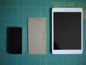 made an iPhone 6plus paper model to see if it was pocketable. iPhone 4 and iPad mini on either side for comparison. http://t.co/eQ0xFdSEHh