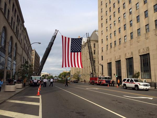 American flag is in place on Broad St for officer Pierson's funeral procession #rip1846 #roc @dandc #rpd http://t.co/ry2GrqLCZL