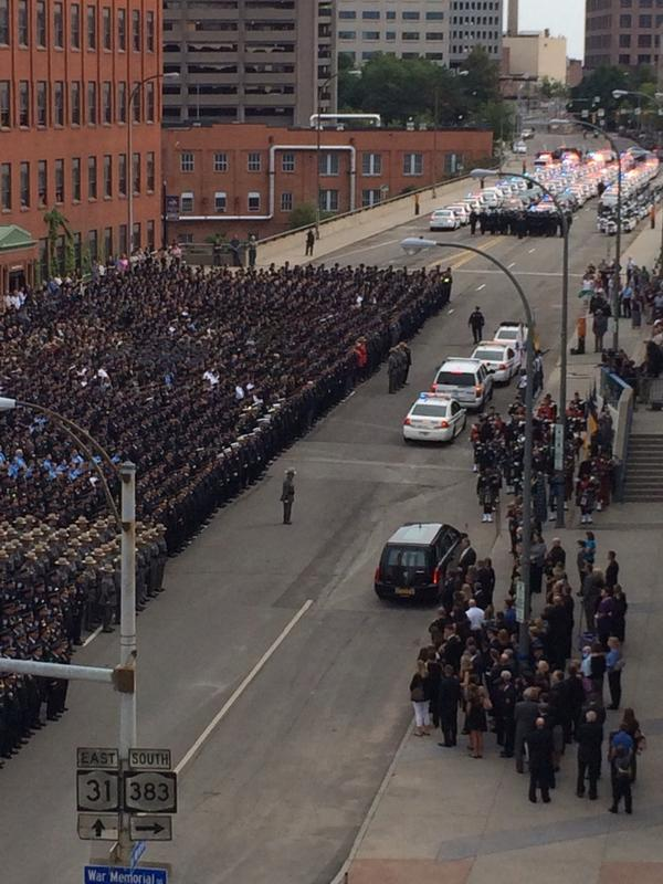 Hearse carrying officer Pierson arrives at @bluecrossarena #roc #rip1846 #rpd @dandc http://t.co/oGeOCnixPE