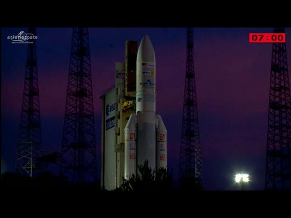 An amazing sky behind a beautiful #Ariane5 rocket.  Wow! http://t.co/Mq9Ny0wzFY