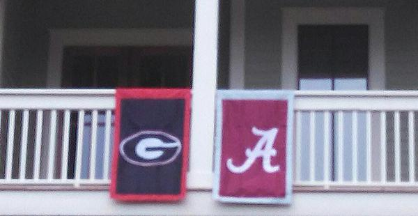 To ensure domestic bliss I hung both of our team's flags...all the time knowing that it spells out GA. #GoDawgs http://t.co/CryuAU8cjc