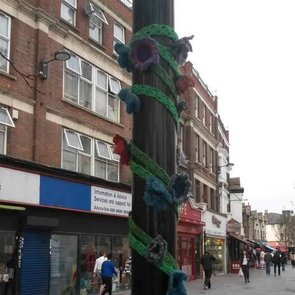 Yarn bombing in Catford. Crochet flowers, Catford Bridge. http://t.co/CwIRATioR6