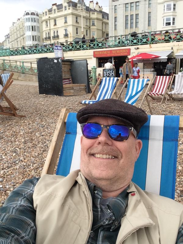 Got to Brighton early; hotel room not ready yet. £2 got me a deck chair with a beach view. @maxwellhoffmann at #TCUK http://t.co/4wXdW8yrCl