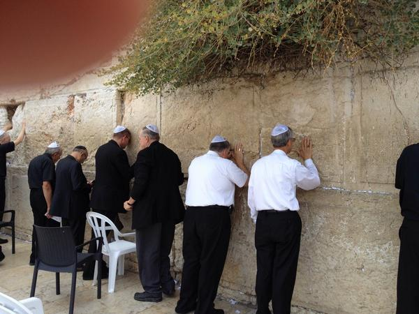 US Bishops on #PeacePilgrimage pray at the Western Wall in Jerusalem.  Join in prayer for peace. http://t.co/PaErFS5Hob