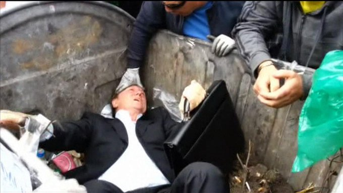 VIDEO: An angry crowd has thrown a Ukrainian MP into a skip outside the country's parliament: http://t.co/CogO8XfvHW http://t.co/iyzqug28N5