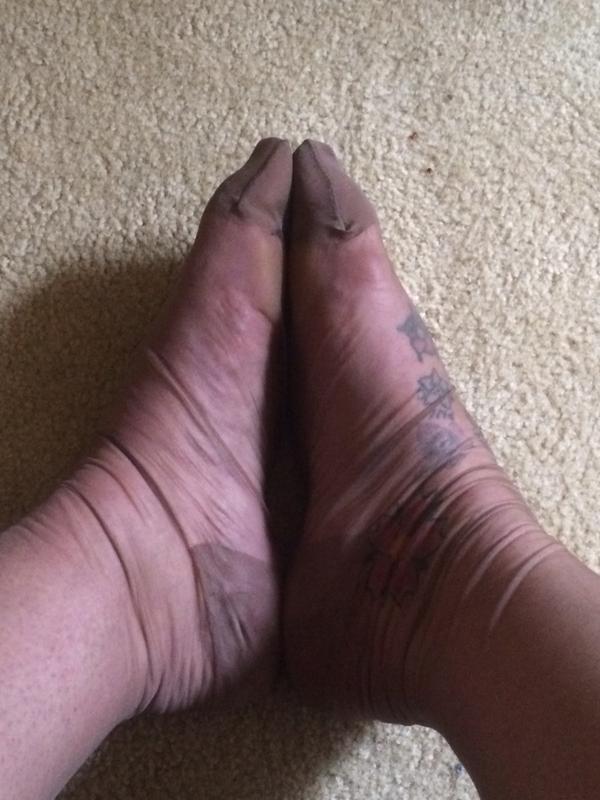 stockinged secretary on twitter tired feet and wrinkled stockings