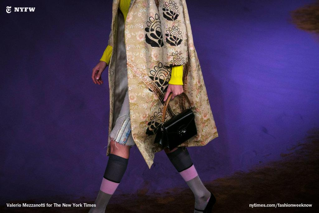 The Prada woman takes care to fray her hems and pull her socks up high. http://t.co/PlDH7VTrYJ http://t.co/5pl8gzGTrZ