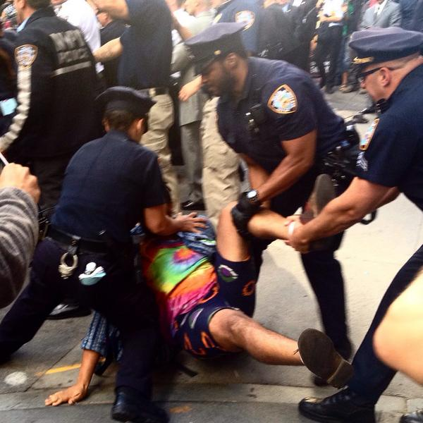 3 #nypd arrest #FloodWallStreet protester as March stopped by police at #WallStreet. http://t.co/1nZQe4P0dI
