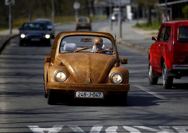 71yr old spends two years crafting a wooden volkswagen beetle from over 50,000 pieces of oak! http://t.co/IcgUnk3BP0 http://t.co/tMdHuDUl8P