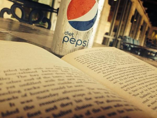 Happiness is a can of Diet Pepsi and a good book. (photo cred: Jasmyne) #PictureWorthyMoments http://t.co/yiqwzcqfpd