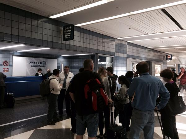 The line of frustrated flyers at one United customer service booth http://t.co/6MIcGdwcQU