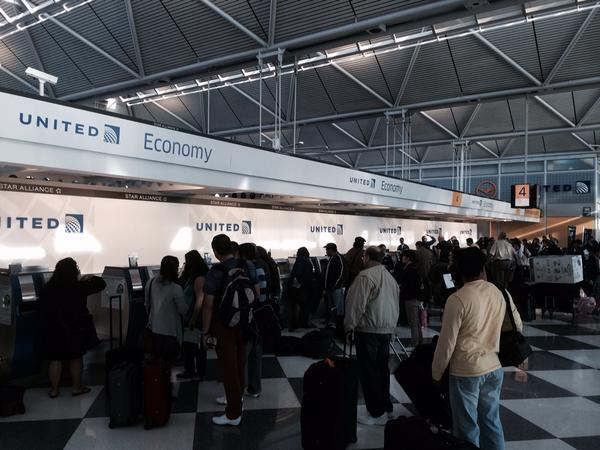 It is not just United but Terminal 1 is packed with people scrambling to get on flights due to cancellations http://t.co/xpe28qoyUe
