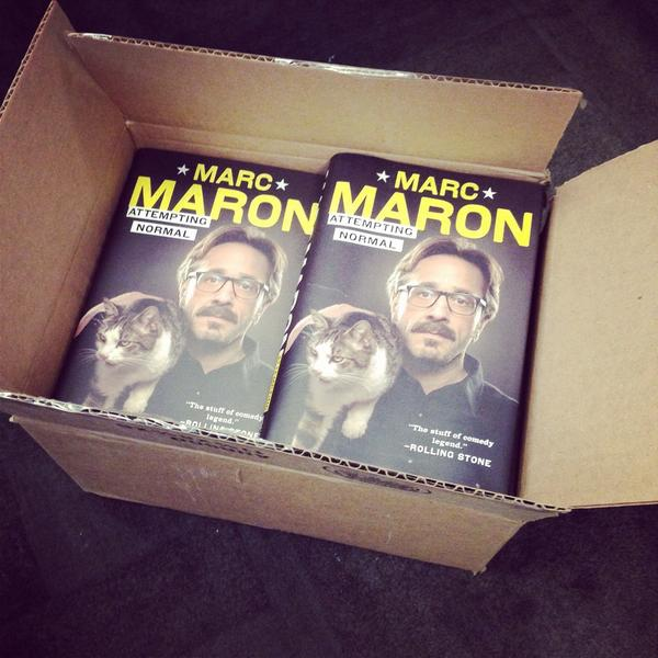 """Oh what do we have here? It's 11 copies of @marcmaron's """"Attempting Normal"""" Follow us & retweet to enter to win. http://t.co/mw3XoVsCg4"""