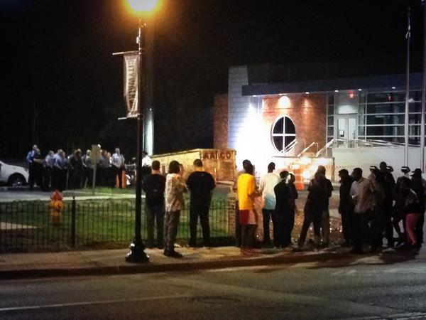 Some protestors across the street standing off with police #Ferguson http://t.co/t1b6co6Jey