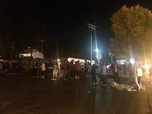 Crowd has gotten smaller in front of #Ferguson police department. http://t.co/lAo0IFaDK5