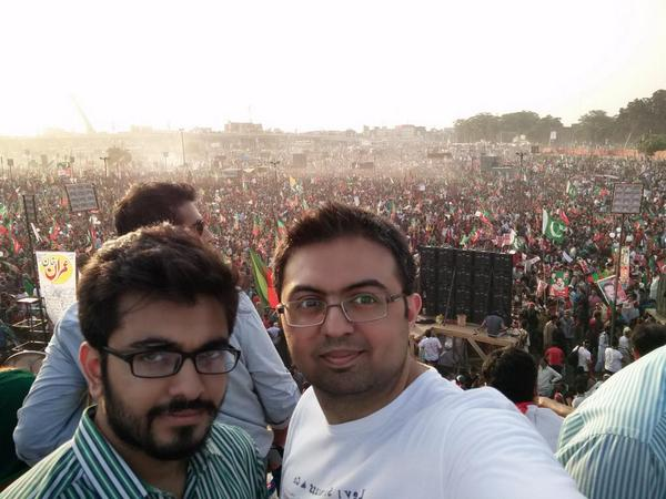 Do you see this crowd behind us?! Me and @emALiBaBa, right now on top of the media container. #Lahore4PTI http://t.co/BBsjcW2QVN