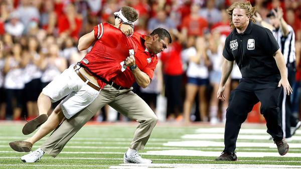 OSU assistant strength coach Anthony Schlegel taught a lesson to a fan who ran on the field. http://t.co/MKPXREY5GX http://t.co/sF62blMXkY