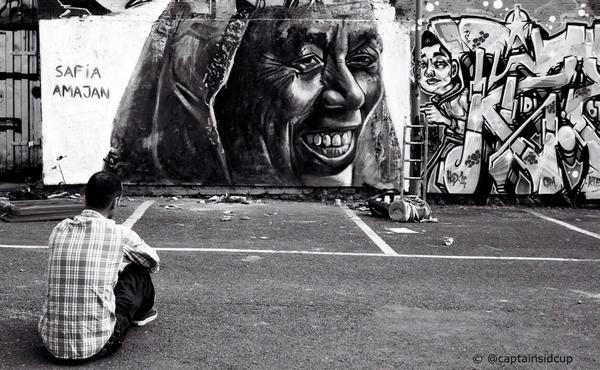 Street artist @FuriaACK admires his latest creation in #BrickLane, London.  #streetart #photography http://t.co/XMs15kRPyT